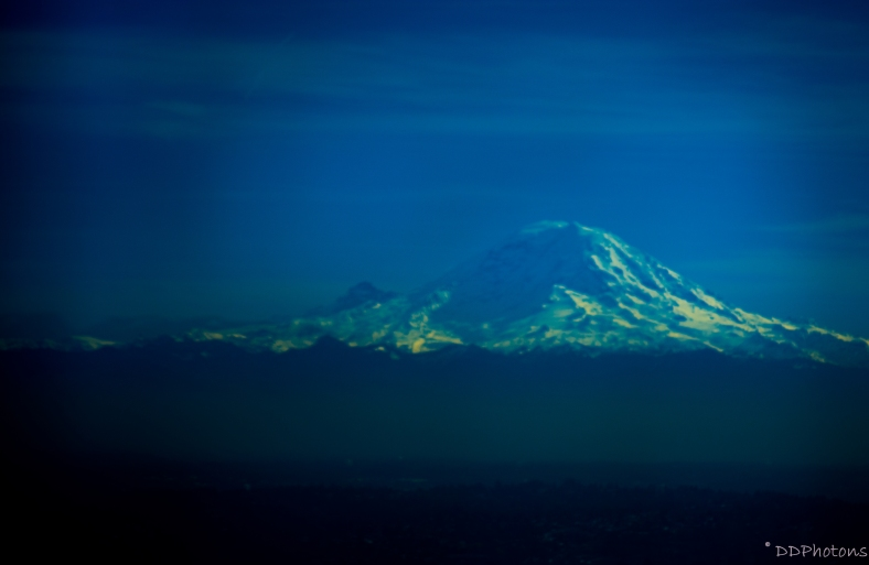 Mt.Rainier bathed in the azure hue of the winter sky